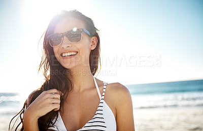 Buy stock photo Shot of a young woman enjoying a day at the beach