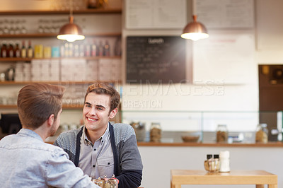 Buy stock photo Shot of a young couple on a coffee date