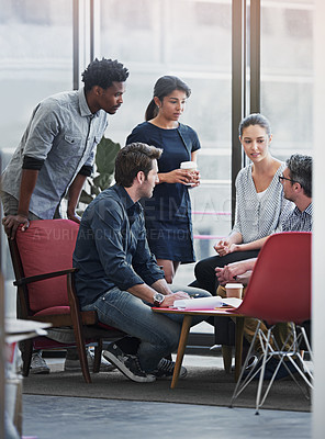Buy stock photo Shot of a group of coworkers in a meeting in an office