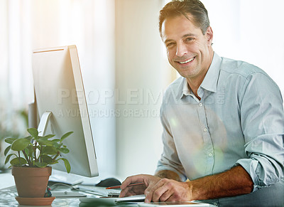 Buy stock photo Portrait of a designer working at his computer in an office