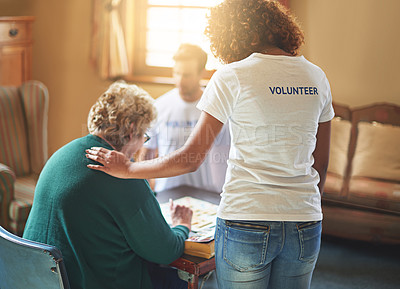 Buy stock photo Shot of volunteers working with seniors at a retirement home