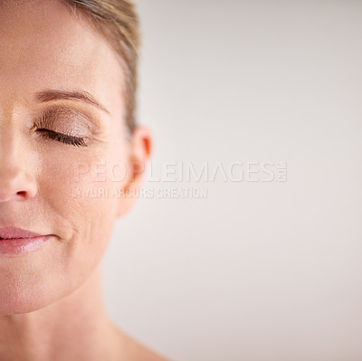 Buy stock photo Cropped studio shot of an attractive mature woman with her eyes closed
