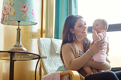 Buy stock photo Shot of a mother with her baby girl at home