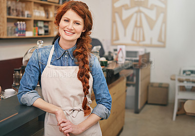 Buy stock photo Cropped portrait of a young female barista standing in the coffee shop