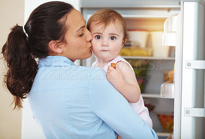 Buy stock photo Shot of an affectionate young mother at home with her baby