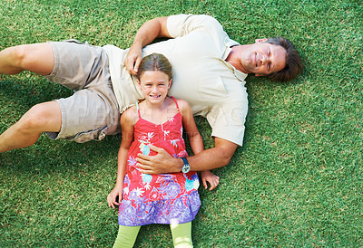 Buy stock photo Top view of father and daughter lying together on grass
