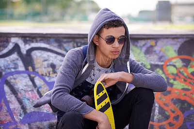 Buy stock photo Shot of a young skateboarder at a skatepark