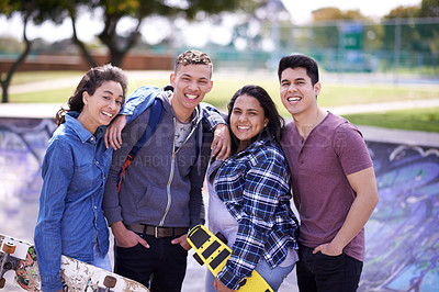 Buy stock photo Shot of a group of friends hanging out together at a skatepark