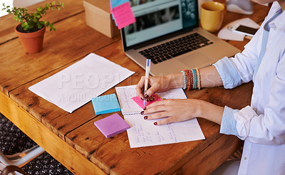 Buy stock photo Cropped shot of an unrecognizable businesswoman working from home