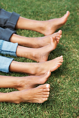 Buy stock photo Closeup of relaxed feet of a family lying together on grass