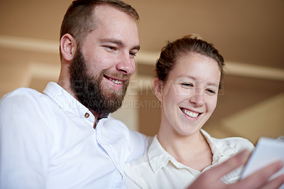 Buy stock photo Shot of a young couple using a digital tablet together at home