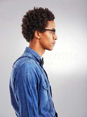 Buy stock photo Studio shot of a young man posing against a gray background