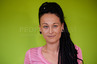 Buy stock photo Portrait of an attractive woman with dreadlocks against a green background