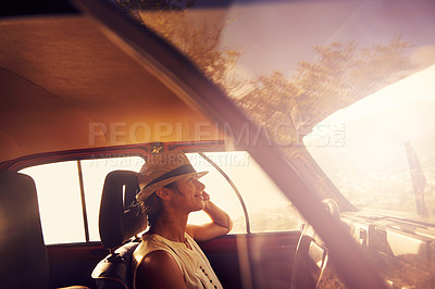 Buy stock photo Shot of a young woman on a road trip