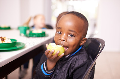 Buy stock photo Cropped shot of a young boy eating a meal