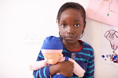 Buy stock photo Cropped shot of a young girl holding her doll