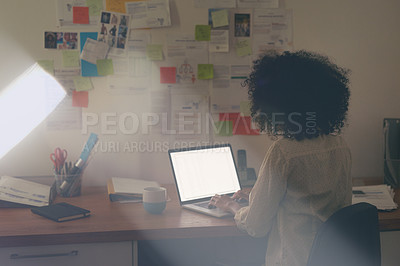 Buy stock photo Shot of a young businesswoman working late at her desk