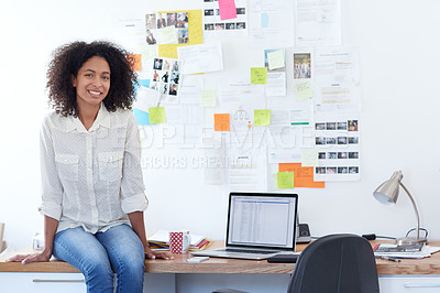 Buy stock photo Portrait of a young designer sitting on her desk in an office