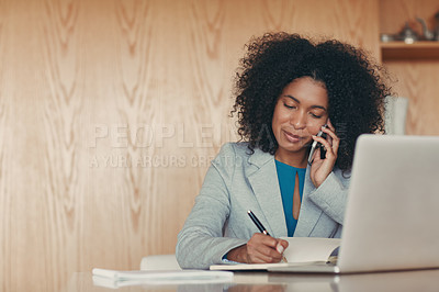 Buy stock photo Shot of a young businesswoman speaking on the phone at her desk in an office