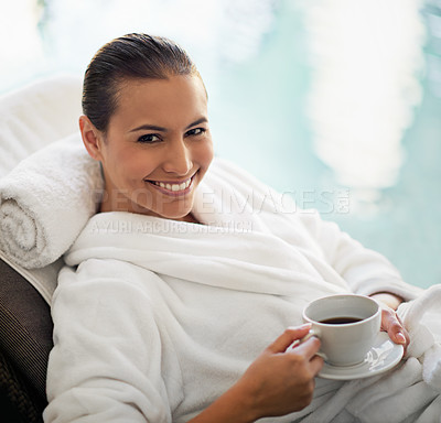 Buy stock photo Shot of a young woman drinking a cup of coffee at the day spa
