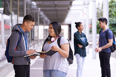 Buy stock photo Shot of a group of smiling university students on campus