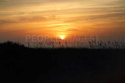 Buy stock photo Shot of a colorful sunset