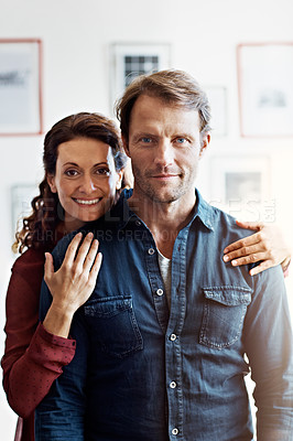 Buy stock photo Portrait of an affectionate mature couple standing in their living room