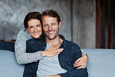 Buy stock photo Portrait of an affectionate mature couple in their living room