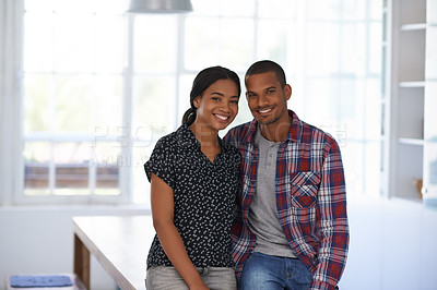 Buy stock photo Portrait of a happy couple leaning on their dining table