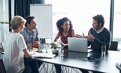 Buy stock photo Shot of a group of coworkers in a boardroom meeting