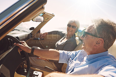Buy stock photo Shot of a happy couple off on a roadtrip together