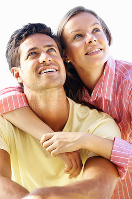 Buy stock photo Smiling couple with woman embracing man from behind and looking away