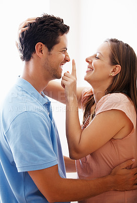 Buy stock photo Playful couple smiling and looking at each other