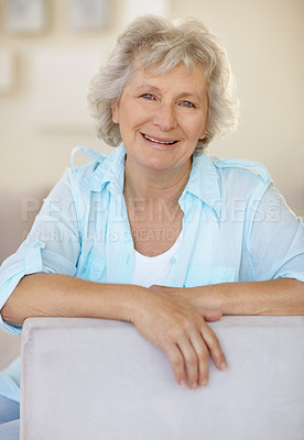 Buy stock photo Portrait of a happy senior woman relaxing on a sofa
