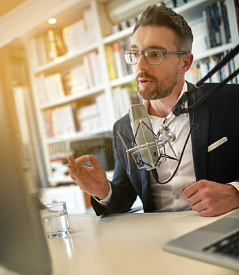 Buy stock photo Shot of a businessman making a podcast on his computer