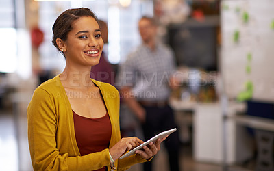 Buy stock photo Cropped shot of a young businesswoman using her digital tablet in the office