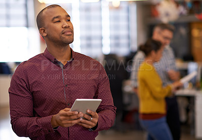 Buy stock photo Cropped shot of an office worker looking thoughtful while holding a digital tablet