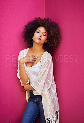 Buy stock photo Shot of an attractive young woman posing against a pink background