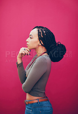 Buy stock photo Profile shot  an attractive young woman posing against a pink background