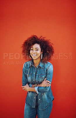 Buy stock photo Portrait of an attractive young woman posing against a red background