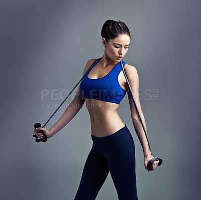 Buy stock photo Studio shot of a sporty young woman against a gray background