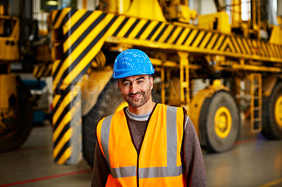 Buy stock photo Portrait of a man in workwear standing in front of a large truck in an industrial building