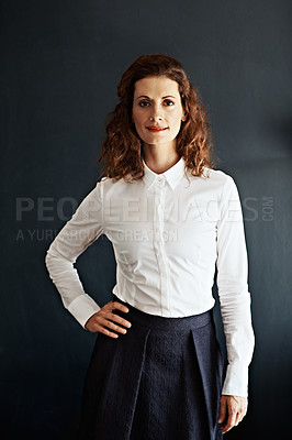 Buy stock photo Studio portrait of a businesswoman against a gray background