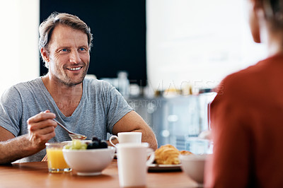 Buy stock photo Shot of a mature couple enjoying breakfast together