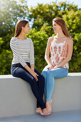 Buy stock photo Shot of two young friends enjoying a day outside together