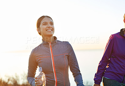 Buy stock photo Shot of two friends talking together after a cross country run