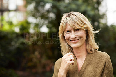 Buy stock photo Portrait of a smiling mature woman standing outside