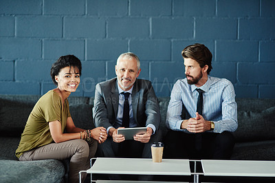 Buy stock photo Portrait of a group of coworkers working together with a digital tablet