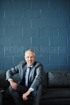Buy stock photo Portrait of a successful businessman sitting on a sofa