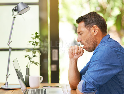Buy stock photo Shot of a man yawning while working from home
